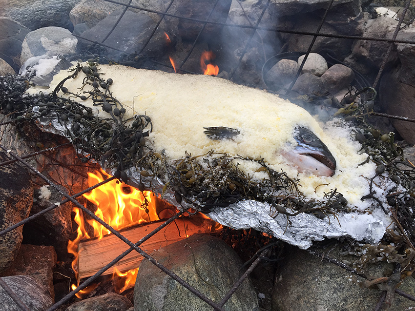 salmon roasted in salt on the fire pit.